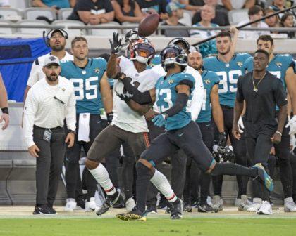 Jaguars trade CB C.J. Henderson for Panthers TE Dan Arnold