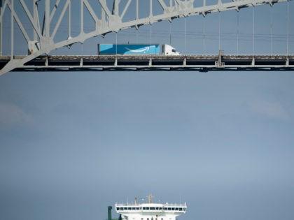 Amazon delivery truck crosses bridge