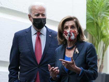 President Joe Biden and House Speaker Nancy Pelosi (D-CA) depart after a House Democratic Caucus meeting on Capitol Hill, October 1, 2021, in Washington, DC. (AP Photo/Alex Brandon)