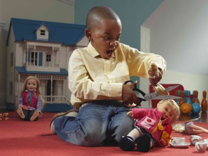 Boy with dolls (Getty)