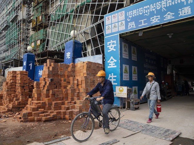 Construction workers head home from The Peak construction project which will be a 55 story complex housing the Shangri-La hotel, offices, residence and restaurants in the Diamond Island area of Phnom Penh on July 31, 2019. (Paula Bronstein/Getty Images )