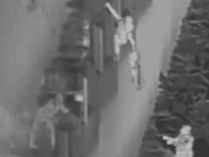 Smuggler drops a child from a border wall in California. (U.S. Border Patrol video screenshot)