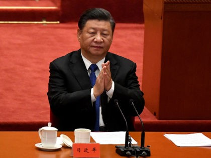 TOPSHOT - Chinese President Xi Jinping attends the commemoration of the 110th anniversary of the Xinhai Revolution which overthrew the Qing Dynasty and led to the founding of the Republic of China, at the Great Hall of the People in Beijing on October 9, 2021. (Photo by Noel Celis / …