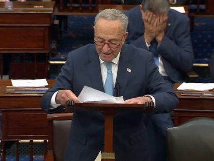 Sen. Joe Manchin reacts to Sen. Chuck Schumer's speech attacking Republicans (Twitter/The Daily Wire)