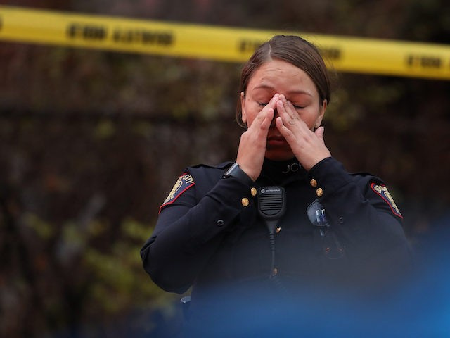 A Jersey City police officer on the scene of a shooting that left multiple people dead on December 10, 2019, in Jersey City, New Jersey. (Rick Loomis/Getty Images)