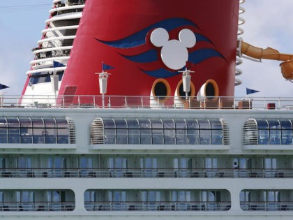 A person leans against the railing of the docked Disney Magic cruise ship at PortMiami amid the virus outbreak on Saturday, March 14, 2020, in Miami. President Donald Trump tweeted yesterday that at his request Carnival, Royal Caribbean, Norwegian, and MSC have all agreed to suspend outbound cruises as the …