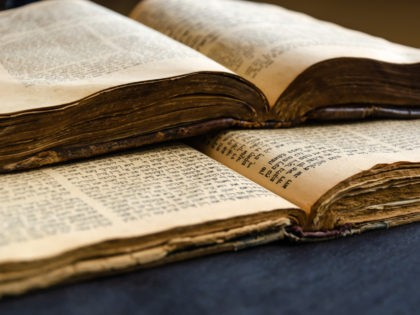 Jewish Bible. An open old Jewish books. Opened scripture pages. Selective focus. Close-up of hebrew text
