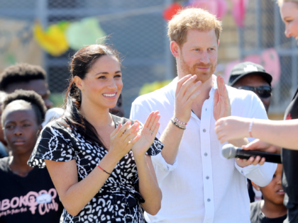 CAPE TOWN, SOUTH AFRICA - SEPTEMBER 23: Meghan, Duchess of Sussex and Prince Harry, Duke of Sussex smile as they visit a Justice Desk initiative in Nyanga township, during their royal tour of South Africa on September 23, 2019 in Cape Town, South Africa. The Justice Desk initiative teaches children …