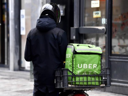 Illustration picture shows An Uber Eats courier in Brussels, Friday 13 March 2020. Federal government announced Yesterday new measures to stop the spreading of Covid-19. Restaurants and cafes will be closed, school lessons are suspended from Monday. Sports and recreational events are cancelled. BELGA PHOTO DIRK WAEM (Photo by DIRK …
