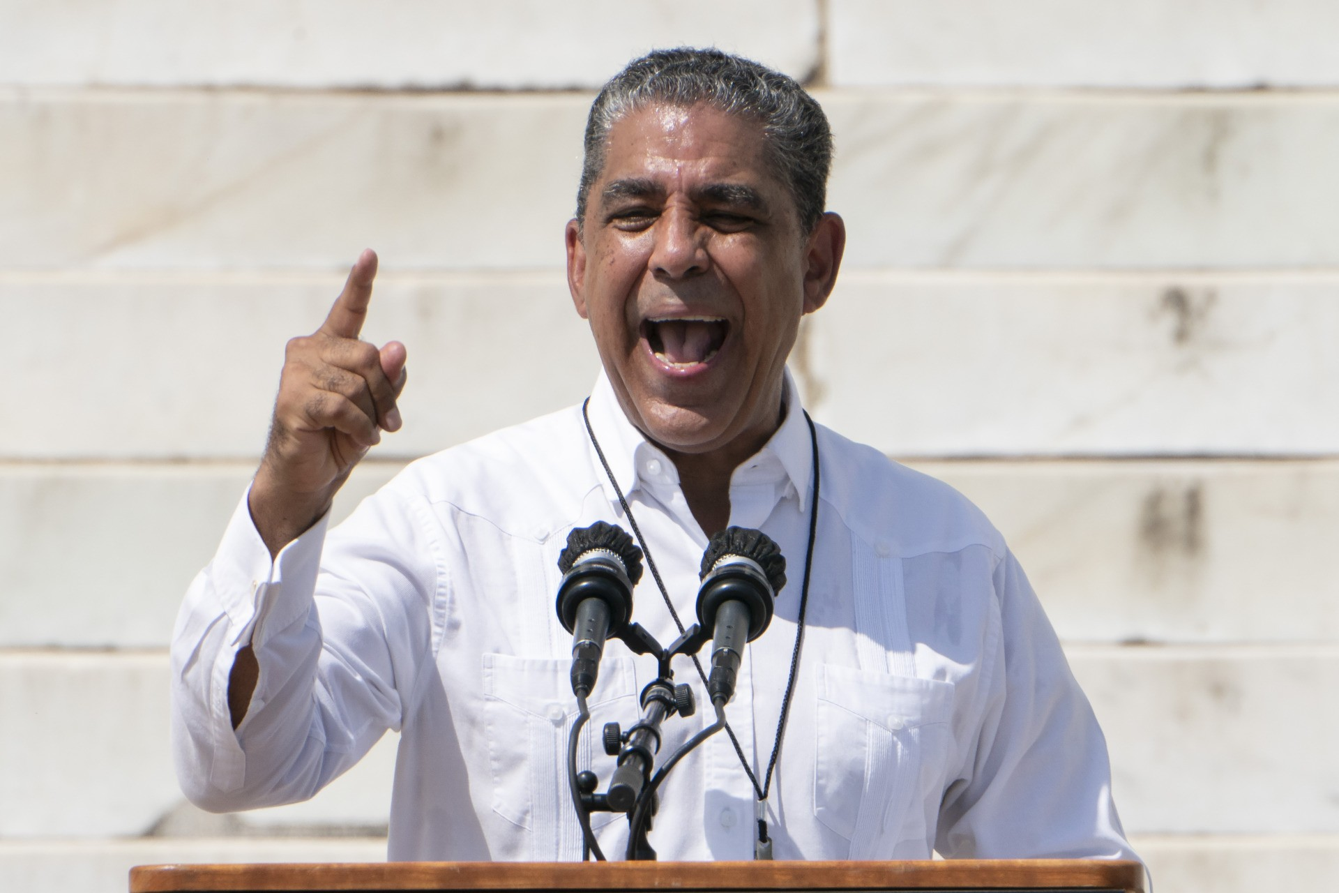 """Rep. Adriano Espaillat, D-N.Y., speaks during the """"Commitment March: Get Your Knee Off Our Necks"""" protest against racism and police brutality, on August 28, 2020, in Washington, DC. - Anti-racism protesters marched on the streets of the US capital on Friday, after a white officer's shooting of African American Jacob Blake. The protester also marked the 57th anniversary of civil rights leader Martin Luther King's historic """"I Have a Dream"""" speech delivered at the Lincoln Memorial. (Photo by Jacquelyn Martin / POOL / AFP) (Photo by JACQUELYN MARTIN/POOL/AFP via Getty Images)"""