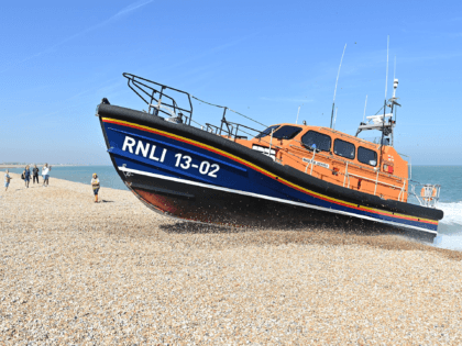 RNLI (Royal National Lifeboat Institution) Shannon class life boat 'The Morrell' drives up onto the beach in Lydd on Sea, near to where migrants have been arriving, in southeast England on September 8, 2021. (Photo by JUSTIN TALLIS / AFP) (Photo by JUSTIN TALLIS/AFP via Getty Images)