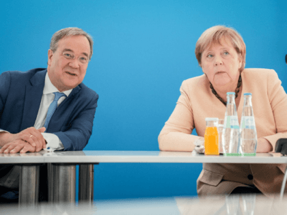 North Rhine-Westphalia's State Premier and the Christian Democratic Union (CDU) candidate for Chancellor Armin Laschet and German Chancellor Angela Merkel talk prior to the party leadership meeting on September 13, 2021 at the CDU's headquatrers in Berlin. (Photo by Kay Nietfeld / POOL / AFP) (Photo by KAY NIETFELD/POOL/AFP via …