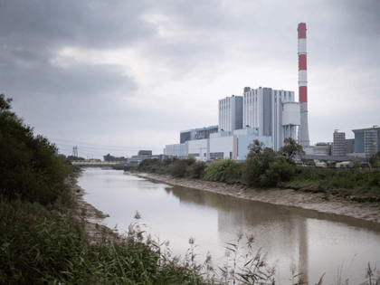 A picture taken on September 16, 2021 in Cordemais, western France shows the coal-fired powerplant of French multinational electric utility company EDF, during a protest against the abandonment of the Ecocombust project which consists of replacing coal by densified biomass pellets. (Photo by Sebastien SALOM-GOMIS / AFP) (Photo by SEBASTIEN …