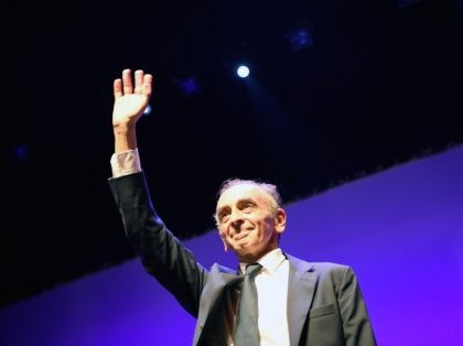 """France's far-right media pundit Eric Zemmour waves as he arrives on stage during his new book """"France hasn't said its last word"""" (La France na pas dit son dernier mot) promotion launch event in Toulon, southern France, on September 17, 2021. - French far-right pundit Eric Zemmour is inching closer …"""
