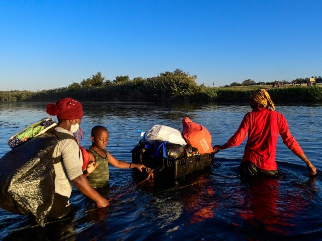 Haitian migrants cross the Rio Grande river as seen from Ciudad Acuna, Coahuila state, Mexico, on September 23, 2021. - Deportation fears mounted Thursday among Haitian migrants camped out in northern Mexico near the border with the United States following the sudden arrival of dozens of police officers at the …