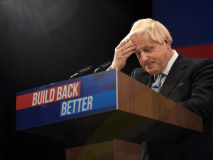 Britain's Prime Minister Boris Johnson gestures as he delivers his keynote speech on the final day of the annual Conservative Party Conference at the Manchester Central convention centre in Manchester, northwest England, on October 6, 2021. (Photo by Oli SCARFF / AFP) (Photo by OLI SCARFF/AFP via Getty Images)