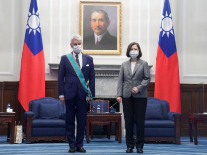 Taiwan President Tsai Ing-wen (R) and French Senator Alain Richard (L) pose for photos at the Presidential Office in Taipei on October 7, 2021. (Photo by CNA Pool / POOL / AFP) (Photo by CNA POOL/POOL/AFP via Getty Images)
