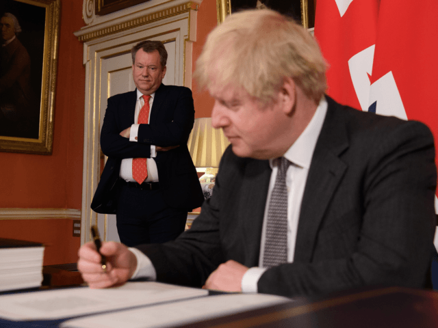 LONDON, ENGLAND - DECEMBER 30: UK chief negotiator David Frost (L) looks on as Prime Minister, Boris Johnson (R) poses for photographs after signing the Brexit trade deal with the EU in number 10 Downing Street on December 30, 2020 in London, United Kingdom. The United Kingdom and the European …