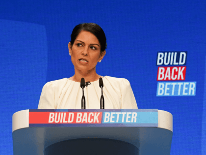 MANCHESTER, ENGLAND - OCTOBER 05: Priti Patel, Secretary of State for the Home Department delivers her keynote speech during the Conservative Party Conference at Manchester Central Convention Complex on October 05, 2021 in Manchester, England. This year's Conservative Party Conference returns as a hybrid of in-person and online events after …