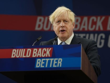 MANCHESTER, ENGLAND - OCTOBER 06: Britain's Prime Minister Boris Johnson delivers his leader's keynote speech during the Conservative Party conference at Manchester Central Convention Complex on October 6, 2021 in Manchester, England. This year's Conservative Party Conference returns as a hybrid of in-person and online events after last year it …
