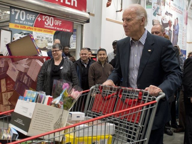 US Vice President Joe Biden pushes a full shopping cart during a visit to a Costco store in Washington, DC, on November 29, 2012, to purchase Christmas gifts. Biden made the visit to the first Costco store located in Washington, DC, during its grand opening. AFP PHOTO / Saul LOEB …
