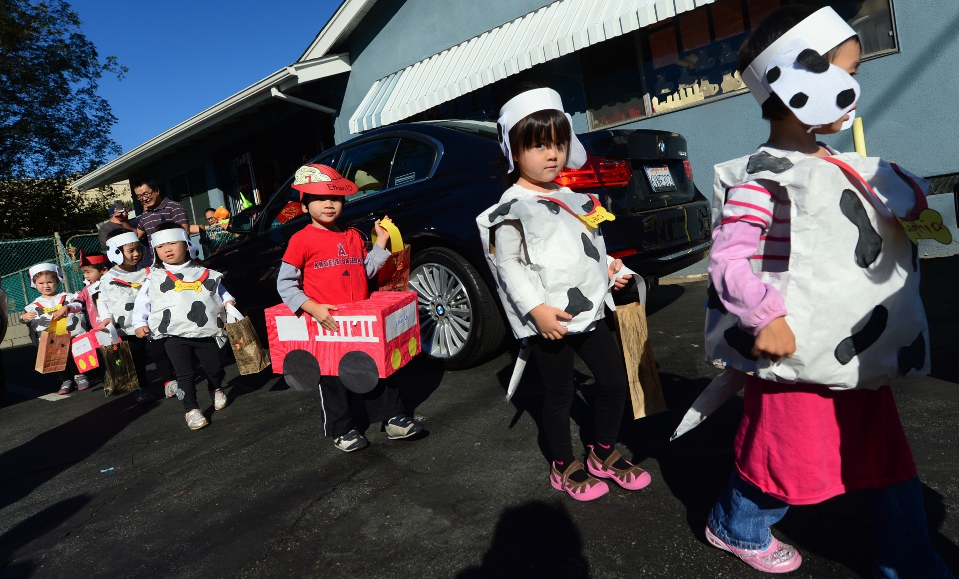 Children from the Happy Day School in Monterey Park, California, celebrate Halloween on October 31, 2013 by going trick or treating at a nearby home which has provided services to the developmentally disabled community since the mid 1950's. AFP PHOTO/Frederic J. BROWN (Photo credit should read FREDERIC J. BROWN/AFP via Getty Images)