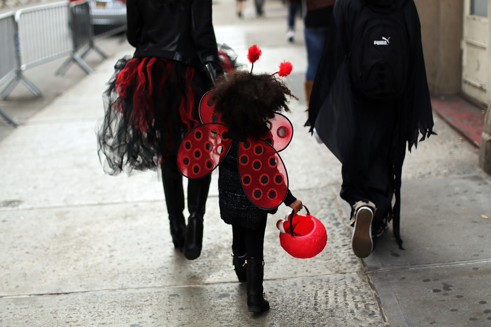 A child walks down a street in a Halloween costume on October 31, 2015 in New York City. Thousands of people are descending on New York City's Greenwich Village as it prepares to host the 42nd Annual Village Halloween Parade which has become one of the nation's largest. (Photo by Spencer Platt/Getty Images)