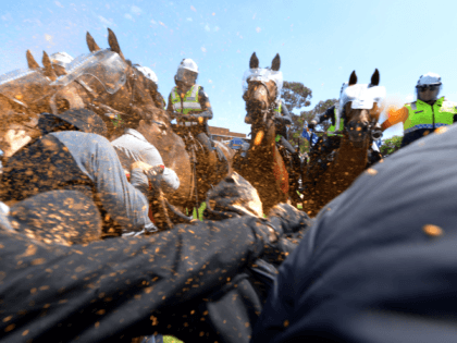 Members of the Campaign Against Racism and Fascism get sprayed with pepper spray as they clash with police on horses as they try to reach the anti-Islam group Reclaim Australia at a protest over plans for a mosque in Melton as Campaign Against Racism and Fascism are holding a counter-rally …