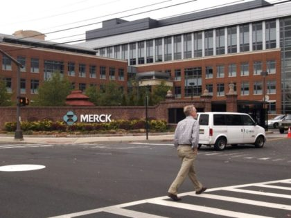 RAHWAY, NJ - NOVEMBER 29: A man walks near the main entrance of a Merck plant November 29, 2005 in Rahway, New Jersey. U.S. pharmaceutical giant Merck, announced plans to cut some 7,000 jobs, or 11 percent of its global workforce, by the end of 2008. (Photo by Marko Georgiev/Getty …