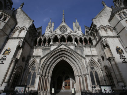 The Royal Courts of Justice building, which houses the High Court of England and Wales, is pictured in London on February 3, 2017. / AFP / Daniel LEAL-OLIVAS (Photo credit should read DANIEL LEAL-OLIVAS/AFP via Getty Images)