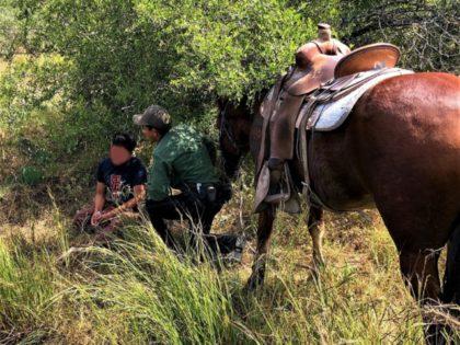A horseback-mounted Border Patrol agent rescues a distressed migrant on a ranch near Hebbronville, Texas. (Photo: U.S. Border Patrol/Laredo Sector)