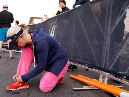 TEMPE, ARIZONA - JANUARY 20: Senator Kyrsten Sinema (D-AZ) laces up her shoes before running in the Humana Rock 'n' Roll 1/2 Marathon on January 20, 2019 in Tempe, Arizona. (Photo by Chris Coduto/Getty Images for Rock 'n' Roll Marathon)