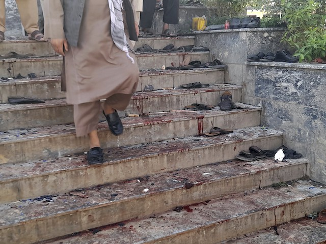 A blood-stained are seen outside a mosque following a bombing in Kunduz province northern Afghanistan, Friday, Oct. 8, 2021. A powerful explosion in a mosque frequented by a Muslim religious minority in northern Afghanistan on Friday has left several casualties, witnesses and the Taliban's spokesman said. (AP Photo/Abdullah Sahil)