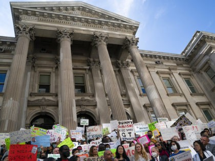 Protesters gather at City Hall to condemn Mayor Bill de Blasio's handling of the Gifted and Talented (G&T) public school program, October 14, 2021, in New York. (AP Photo/John Minchillo)