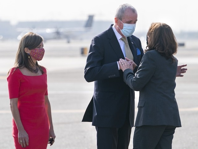 Vice President Kamala Harris is greeted by New Jersey Gov. Phil Murphy, center, and his wife Tammy Snyder Murphy, as Harris arrives in Newark, New Jersey, October 8, 2021. (AP Photo/Jacquelyn Martin)