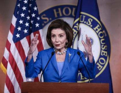 WASHINGTON, DC - OCTOBER 12: House Speaker Nancy Pelosi (D-CA) gestures as she speaks at a news conference at the U.S. Capitol on October 12, 2021 in Washington, DC. The House of Representatives are back in session for one day to consider legislation to lift the debt limit through early …