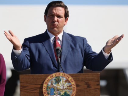 Florida Governor Ron DeSantis speaks during a press conference about the opening of a COVID-19 vaccination site at the Hard Rock Stadium on January 06, 2021 in Miami Gardens, Florida. The governor announced that the stadium's parking lot which offers COVID-19 tests will begin to offer COVID-19 vaccinations for residents …