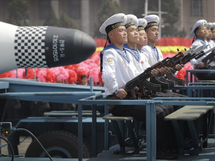 """In this April 15, 2017, file photo, navy personnel sit in front of a submarine-launched """"Pukguksong"""" ballistic missile (SLBM) as it is paraded across Kim Il Sung Square in Pyongyang, North Korea. (AP Photo/Wong Maye-E, File)"""