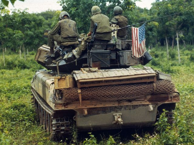 American troops on an assault vehicle awaiting orders, Vietnam, circa 1966. (MPI/Getty Images)