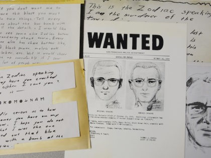 In this May 3, 2018, file photo, a San Francisco Police Department wanted bulletin and copies of letters sent to the San Francisco Chronicle by a man who called himself Zodiac are displayed in San Francisco. A coded letter mailed to a San Francisco newspaper by the Zodiac serial killer …