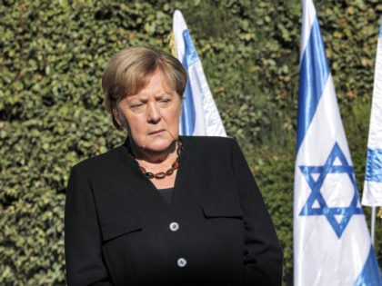 German Chancellor Angela Merkel pauses during a reception outside the Yad Vashem Holocaust Museum in Jerusalem on October 10, 2021. (Photo by Gil COHEN-MAGEN / AFP) (Photo by GIL COHEN-MAGEN/AFP via Getty Images)