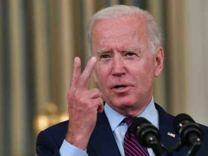 """US President Joe Biden gestures as he delivers remarks on the debt ceiling from the State Dining Room of the White House on October 4, 2021 in Washington, DC. - President Joe Biden on Monday called Republican opponents """"reckless and dangerous"""" for refusing to join Democrats in raising the US …"""