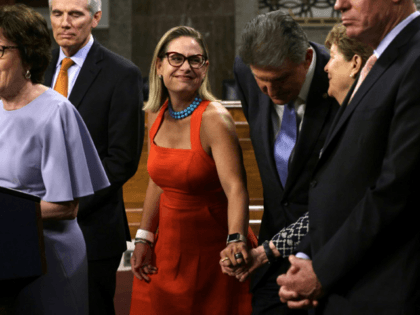 U.S. Sen. Kyrsten Sinema (D-AZ) (3rd L) shares a moment with Sen. Jeanne Shaheen (D-NH) (2nd R) during a news conference after a procedural vote for the bipartisan infrastructure framework at Dirksen Senate Office Building July 28, 2021 on Capitol Hill in Washington, DC. The Senate has advanced the bipartisan …