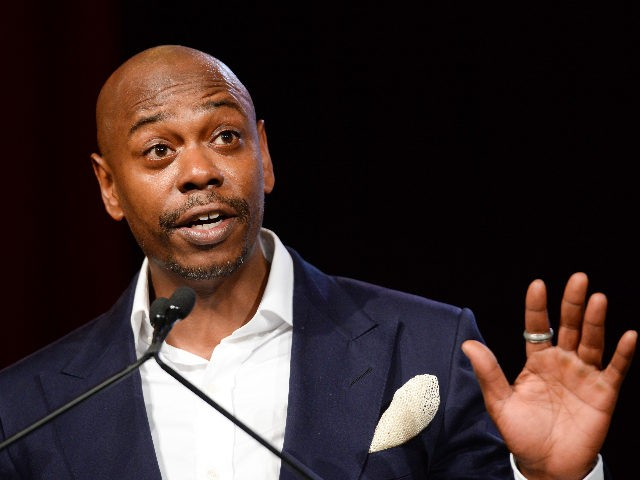 Comedian Dave Chappelle speaks on stage at the RUSH Philanthropic Arts Foundation's Art for Life Benefit at Fairview Farms in Water Mill on Saturday, July 18, 2015, in New York. (Photo by Scott Roth/Invision/AP)