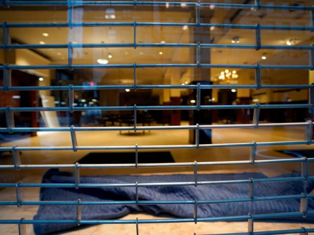 A closed Brooks Brothers clothing retailer in New York on January 26, 2021 - Boarded-up stores, shuttered restaurants and empty office towers: Covid-19 has turned New York's famous business districts into ghost towns, with companies scrambling to come up with ways to entice workers to return post-pandemic. (Photo by TIMOTHY …