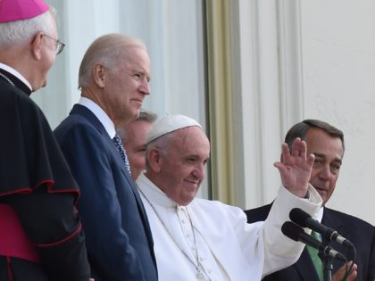 Sept 24, 2015; Washington, DC, USA; Pope Francis waves to the crowd from a balcony of the US Capital Building after addressing a joint session of Congress. With Pope Francis are, among others, Vice President Joe Biden, Speaker of the house John Boehner, and Congresswoman Nancy Pelosi. Mandatory Credit: Michael …