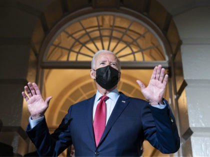 FILE - In this Oct. 1, 2021, file photo President Joe Biden speaks with reporters as he departs after a House Democratic Caucus meeting on Capitol Hill in Washington. (AP Photo/Alex Brandon, File)