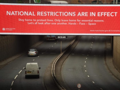 A billboard displays a Manchester City Council message about the about the national lockdown restrictions to combat the novel coronavirus pandemic in Manchester, northwest England, on November 26, 2020. - The UK announced details of a new tiered system of coronavirus restrictions on public life that is set to replace …