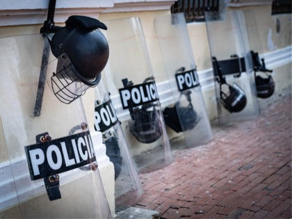 Police equipment such as shield and helmet on the street - stock photo