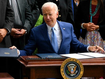 US President Joe Biden looks on after signing three proclamations restoring protections stripped by the Trump administration for Bears Ears, Grand Staircase-Escalante, and Northeast Canyons and Seamounts national monuments, on the North Lawn of the White House on October 8, 2021 in Washington, DC. (Photo by Olivier DOULIERY / AFP) …